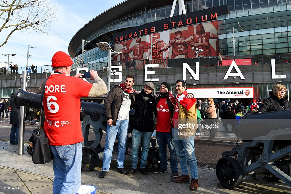Arsenal fans pose outside the stadium before the Barclays Premier League match between Arsenal and Leicester City at Emirates Stadium on February 14, 2016 in London, England.