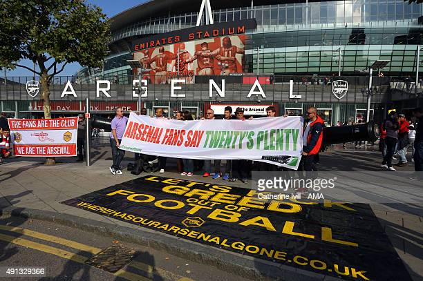 Arsenal fans protest about high ticket prices outside the stadium before the Barclays Premier League match between Arsenal and Manchester United at...