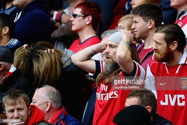 Arsenal fans react during the Barclays Premier League match between Everton and Arsenal at Goodison Park on April 6 2014 in Liverpool England
