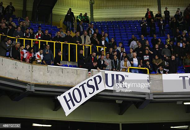 Arsenal fans remove hoardings after their victory in the Capital One Cup third round match between Tottenham Hotspur and Arsenal at White Hart Lane...