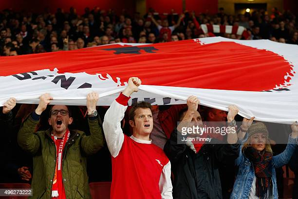 Arsenal fans show display a poppy flag during the Barclays Premier League match between Arsenal and Tottenham Hotspur at the Emirates Stadium on...