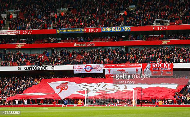 Arsenal fans show their support prior to the Barclays Premier League match between Arsenal and Chelsea at Emirates Stadium on April 26 2015 in London...