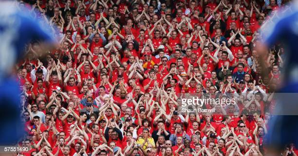 Arsenal fans sing during the Barclays Premiership match between Arsenal and Wigan Athletic at Highbury on May 7 2006 in London England The match was...