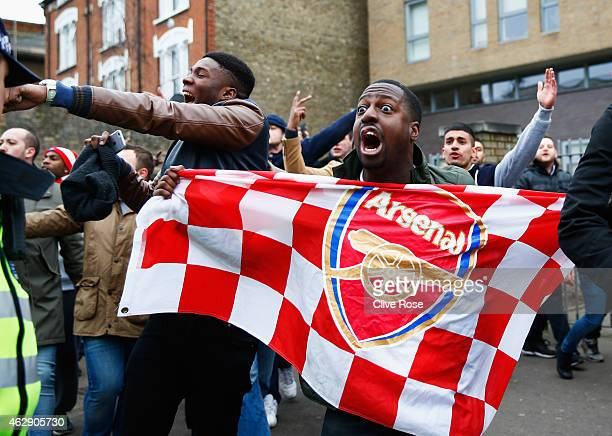 Arsenal fans sing outside the ground prior to the Barclays Premier League match between Tottenham Hotspur and Arsenal at White Hart Lane on February...