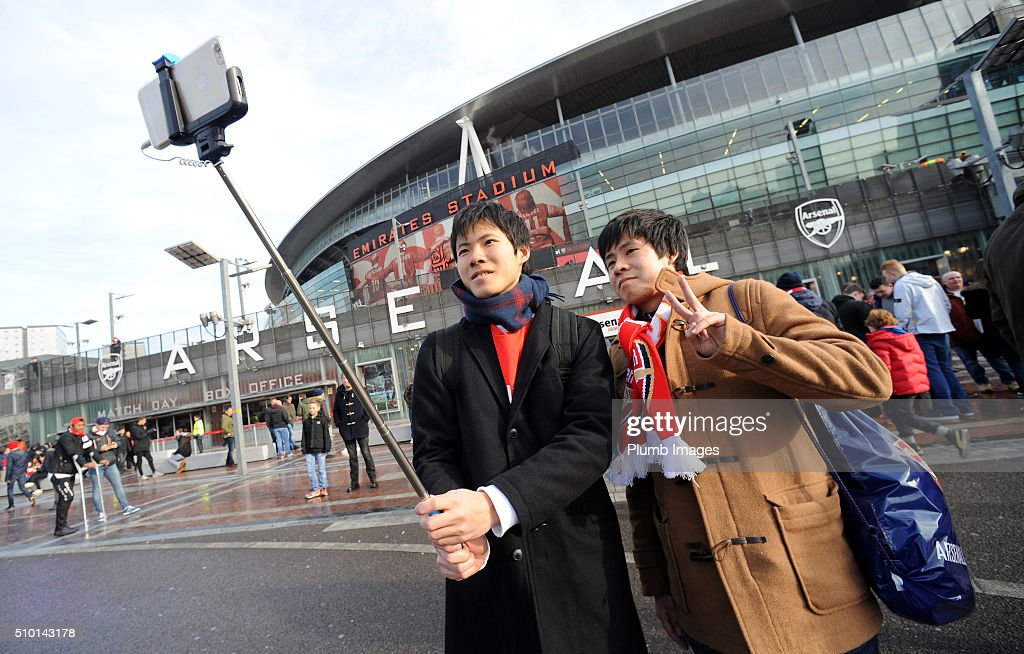 Arsenal fans take a selfie outside The Emirates Stadium ahead of the Barclays Premier League match between Arsenal and Leicester City at Emirates Stadium on February 14, 2016 in London, United Kingdom.