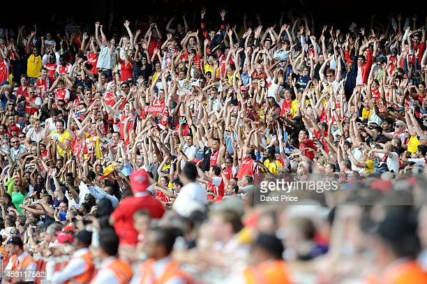 Arsenal fans take part in a Mexican Wave during the Emirates Cup match between Arsenal and AS Monaco at Emirates Stadium on August 3 2014 in London...