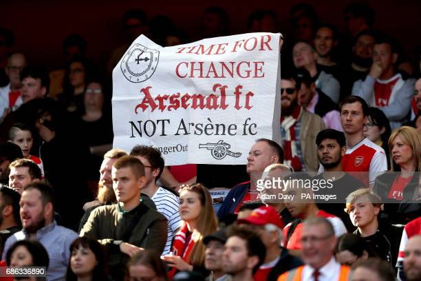 Arsenal fans with a banner reading 'Time For Change Arsenal FC NOT Arsene FC' during the Premier League match at the Emirates Stadium London