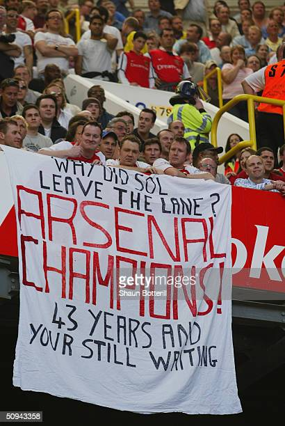Arsenal fans with celebratory banner during the FA Barclaycard Premiership match between Tottenham Hotspur and Arsenal at White Hart Lane on April 25...