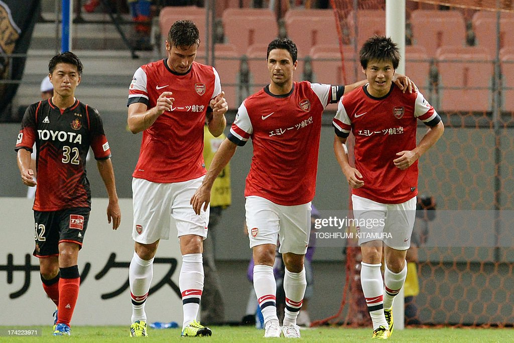 Arsenal FC forward Ryo Miyauchi (R) is celebrated his score by teammates during their friendly match against Nagoya Grampus in Toyota, Aichi prefecture on July 22, 2013.