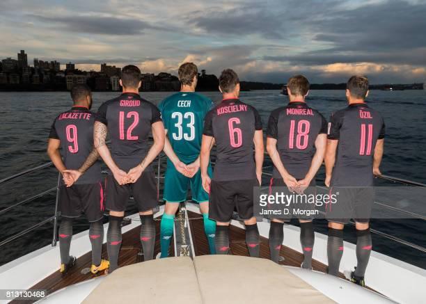 Arsenal FC players Laurent Koscielny Petr Cech Alexandre Lacazette Olivier Giroud Mesut Ozil and Nacho Monreal look out on Sydney Harbour en route to...