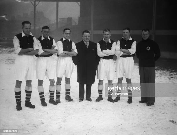 Arsenal FC players manager and trainer standing in the snow at the Arsenal Stadium Highbury North London 29th January 1935 From left to right George...