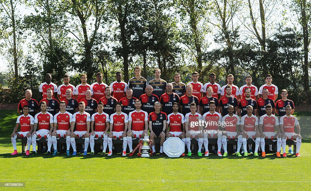 Arsenal FC Squad for season 2015/16. Back row (left to right) Joel Campbell, Francis Coquelin, Mathieu Flamini, Alex Iwobi, Calum Danny Welbeck, Matt Macey, Petr Cech, David Ospina, Gabriel, Jeff eine-Adelaide, Nacho Monreal, Mathieu Debuchy, Hector Bellerin. Middle row (left to right) Vic Akers (kit manager), Paul Akers (assistant kit manager), Tony Colbert (fitness coach), Darren Page (masseur), Shad Forsythe (head of athletic performance enhancement), Neil Banfield (first team coach), Boro Primorac (first team coach), Steve Bould (assistant manager), Gerry Peyton (goalkeeping coach), Colin Lewin (head of medical services), Chris Harvey (masseur), Barry Solan (1st team strength and conditioning coach) Paul Johnson (equipment manager). Front row (left to right) Alexis Sanchez, Jack Wilshere, Calum Chambers, Aaron Ramsey, Mesut Ozil, Tomas Rosicky, Per Mertesacker, Arsene Wenger (manager), Mikel Arteta, Laurent Koscielny, Olivier Giroud, Theo Walcott, Kieran Gibbs, Alex Oxlade-Chamberlain, Santi Cazorla. at London Colney on September 10, 2015 in St Albans, England.