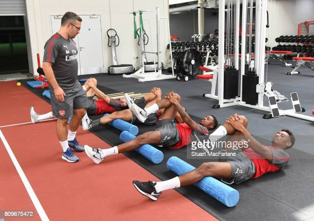 Arsenal fitness coach Ben Ashworth with Chuba Akpom and Jeff ReineAdelaide during a training session at London Colney on July 6 2017 in St Albans...