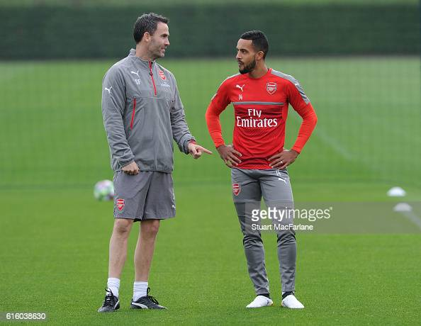Arsenal fitness coach Shad Forsythe with Theo Walcott before a training session at London Colney on October 21 2016 in St Albans England