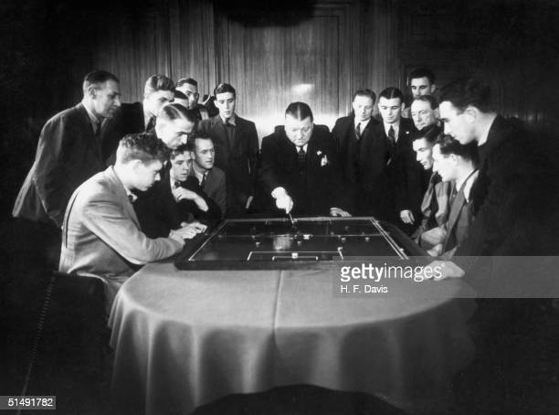 Arsenal football club manager George Allison rehearsing tactics with the team November 1938