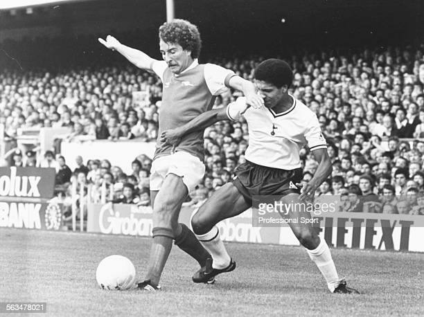 Arsenal Football Club striker Alan Sunderland holds off a challenge from Tottenham Hotspur fullback Chris Hughton during a First Division match at...