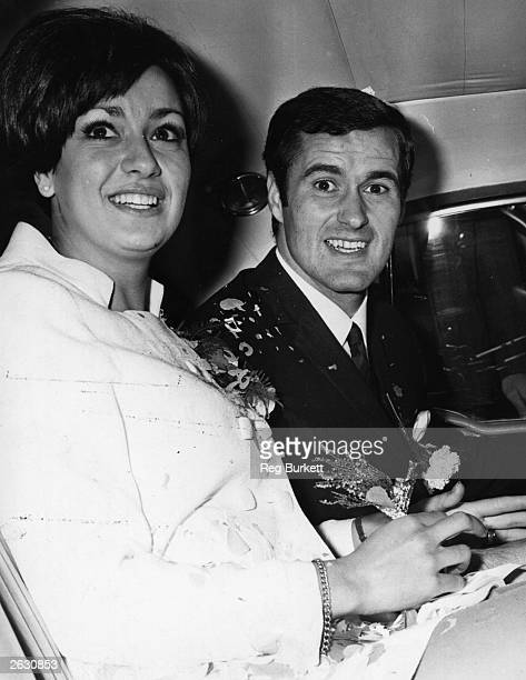 Arsenal footballer George Graham with his new wife model Marie Zia after their wedding at Marylebone Registrar office London