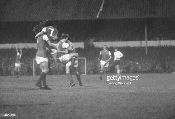 Arsenal footballers Charlie George George Armstrong Eddie Kelly and Ray Kennedy celebrate Ray Kennedy's goal at Tottenham Hotspur's home ground White...