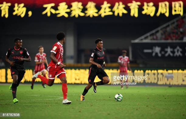 Arsenal forward Alex Iwobi vies for the ball during the International Champions Cup football match between Bayern Munich and Arsenal in Shanghai July...
