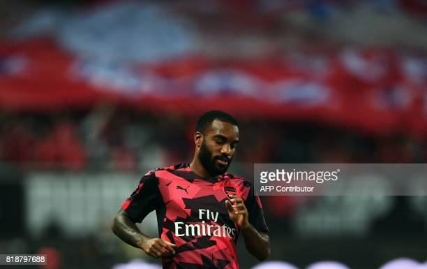 Arsenal forward Alexandre Lacazette warms up before the International Champions Cup football match between Bayern Munich and Arsenal in Shanghai July...