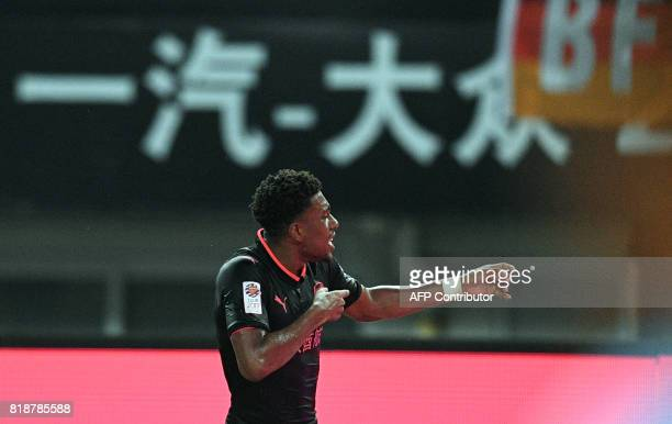 Arsenal forward Arsenal forward Alex Iwobi celebrates after scoring an equalising goal during the International Champions Cup football match between...