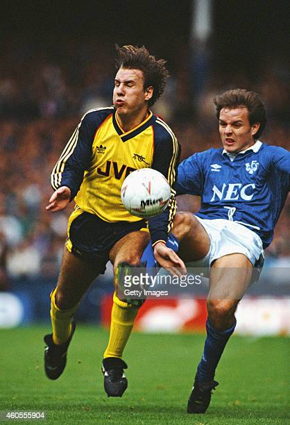 Arsenal forward Paul Merson is challenged by John Ebbrell of Everton during a League Division One match between Everton and Arsenal at Goodison Park...
