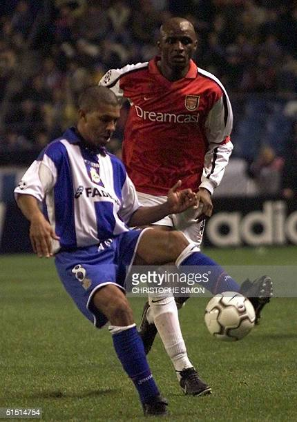Arsenal French Patrick Vieira vies with Bazilian Djalminha in a Champions' League match in Riazior stadium in Coruna 21 November 2001