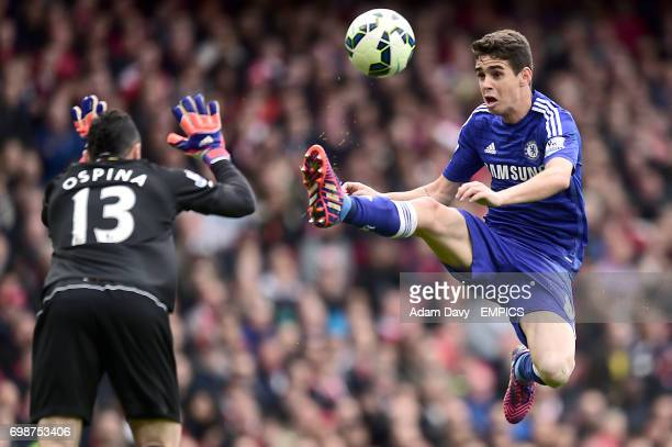 Arsenal goalkeeper David Ospina and Chelsea's Oscar battle for the ball