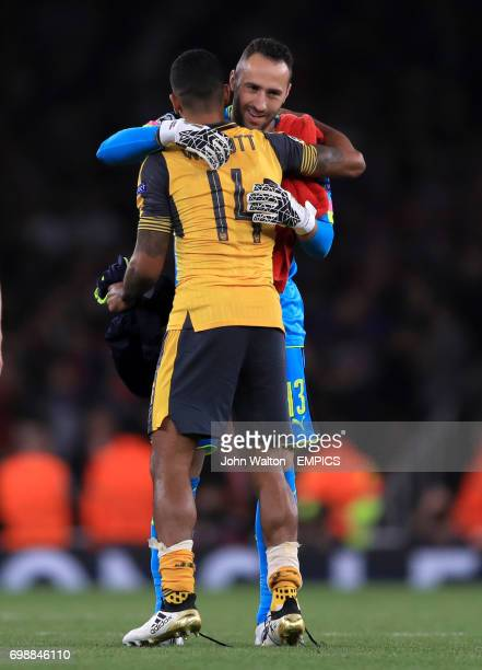 Arsenal goalkeeper David Ospina and Theo Walcott embrace after the game