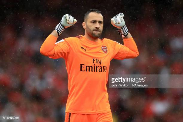 Arsenal goalkeeper David Ospina celebrates his side's fourth goal of the game during the Emirates Cup match at the Emirates Stadium London