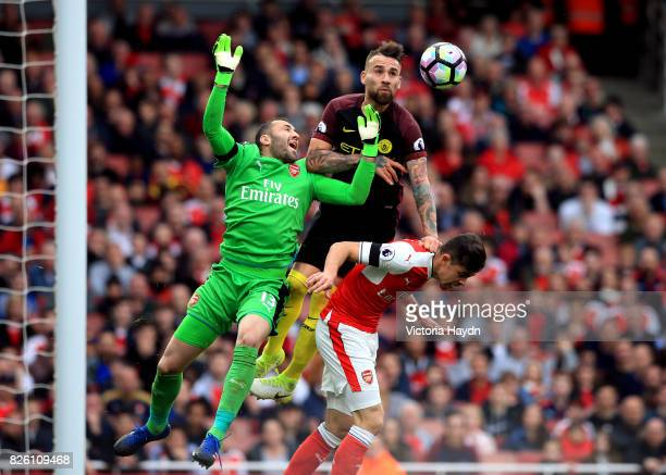 Arsenal goalkeeper David Ospina drops the ball under pressure from Manchester City's Nicolas Otamendi