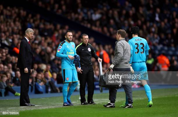 Arsenal goalkeeper David Ospina replaces goalkeeper Petr Cech after he picks up an injury during the Premier League match at The Hawthorns West...