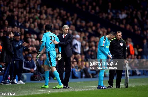 Arsenal goalkeeper David Ospina replaces goalkeeper Petr Cech after he picks up an injury as Arsenal manager Arsene Wenger looks on during the...