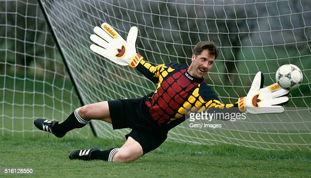 Arsenal goalkeeper David Seaman in action with oversized gloves during an Adidas coaching session circa 1993