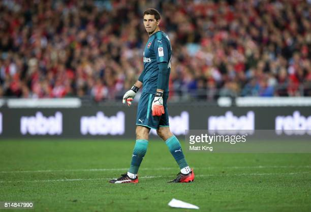 Arsenal goalkeeper Emiliano Martinez looks at a paper plane that was thrown onto the pitch during the match between the Western Sydney Wanderers and...
