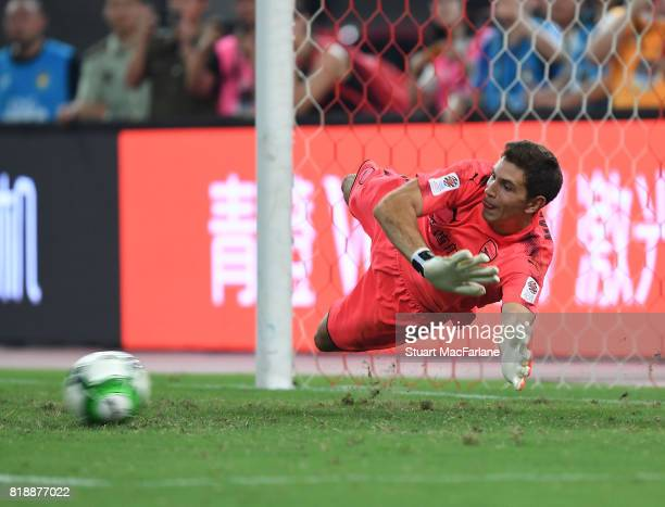 Arsenal goalkeeper Emiliano Martinez saves the 5th Bayern Munich penalty in the shoot out during a pre season friendly between Bayern Munich and...