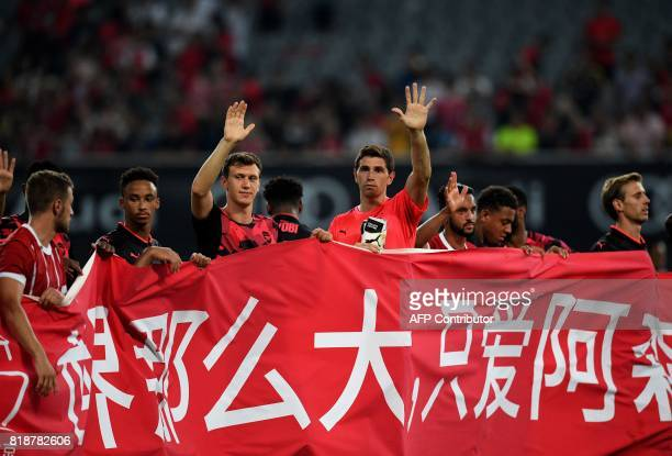 Arsenal goalkeeper Emiliano Martinez waves after the International Champions Cup football match between Bayern Munich and Arsenal in Shanghai July 19...