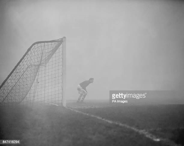 Arsenal goalkeeper Jack Kelsey peers into the fog searching for the elusive ball The fog was so thick the game was eventually stopped