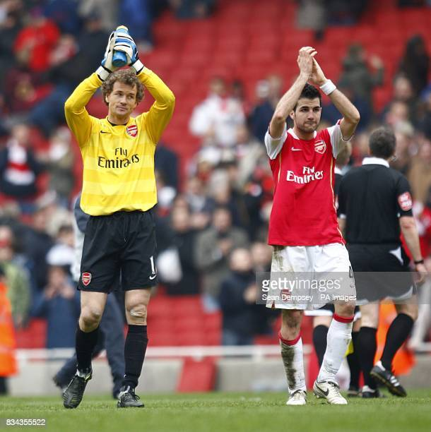 Arsenal goalkeeper Jens Lehmann and team mate Francesc Fabregas 9r applaud the fans after the final whistle
