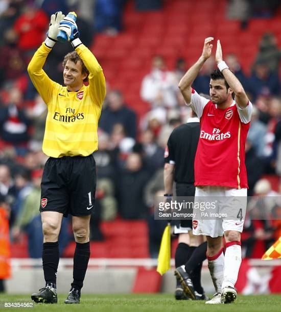 Arsenal goalkeeper Jens Lehmann and team mate Francesc Fabregas applaud the fans after the final whistle