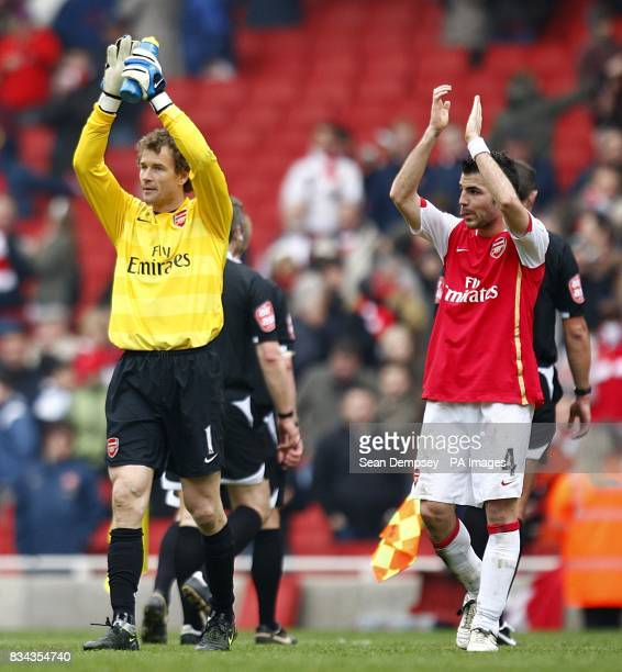 Arsenal goalkeeper Jens Lehmann and team mate Francesc Fabregas applaud the fans