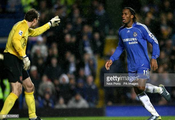 Arsenal goalkeeper Jens Lehmann points an accusing finger at Chelsea's Didier Drogba