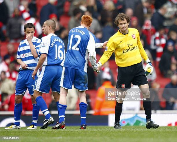 Arsenal goalkeeper Jens Lehmann shakes hands with Reading's Dave Kitson