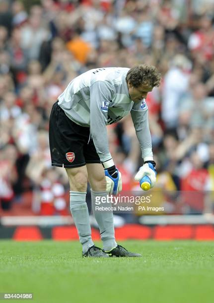 Arsenal goalkeeper Jens Lehmann takes a bow as he says goodbye to the Arsenal fans after his last match at the Emirates Stadium