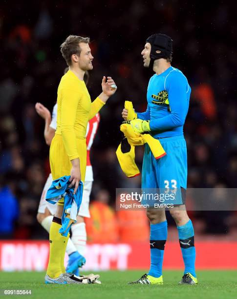 Arsenal goalkeeper Petr Cech and Liverpool goalkeeper Simon Mignolet