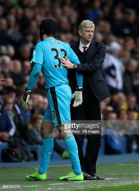 Arsenal goalkeeper Petr Cech and manager Arsene Wenger during the Premier League match at The Hawthorns West Bromwich