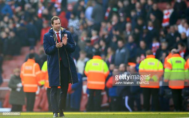 Arsenal goalkeeper Petr Cech applauds the fans after the final whistle