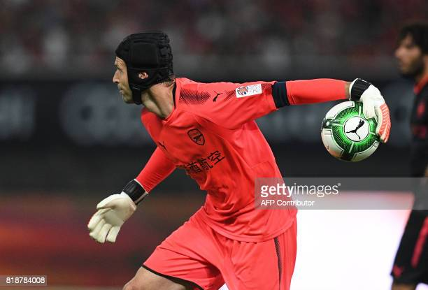 Arsenal goalkeeper Petr Cech handles the ball during the International Champions Cup football match between Bayern Munich and Arsenal in Shanghai on...