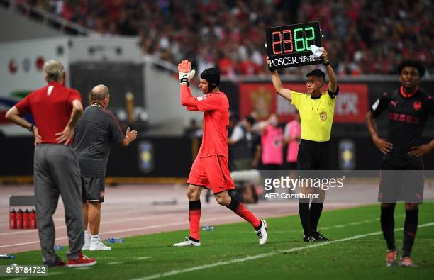 Arsenal goalkeeper Petr Cech leaves the pitch during the International Champions Cup football match between Bayern Munich and Arsenal in Shanghai on...