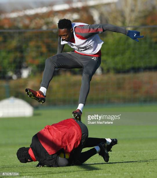 Arsenal goalkeeper Petr Cech saves at the feet of Danny Welbeck during a training session at London Colney on November 17 2017 in St Albans England